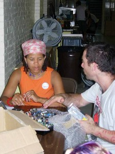 Volunteers unwrap a transmitter board. Florence, MA, 2005
